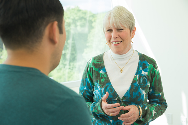 OHSU Social Worker and care expert discusses cancer care options with a patient