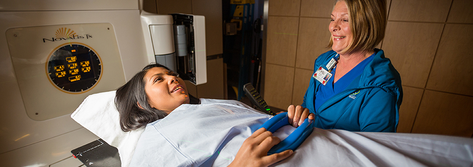 Provider putting patient at ease during radiation treatment.