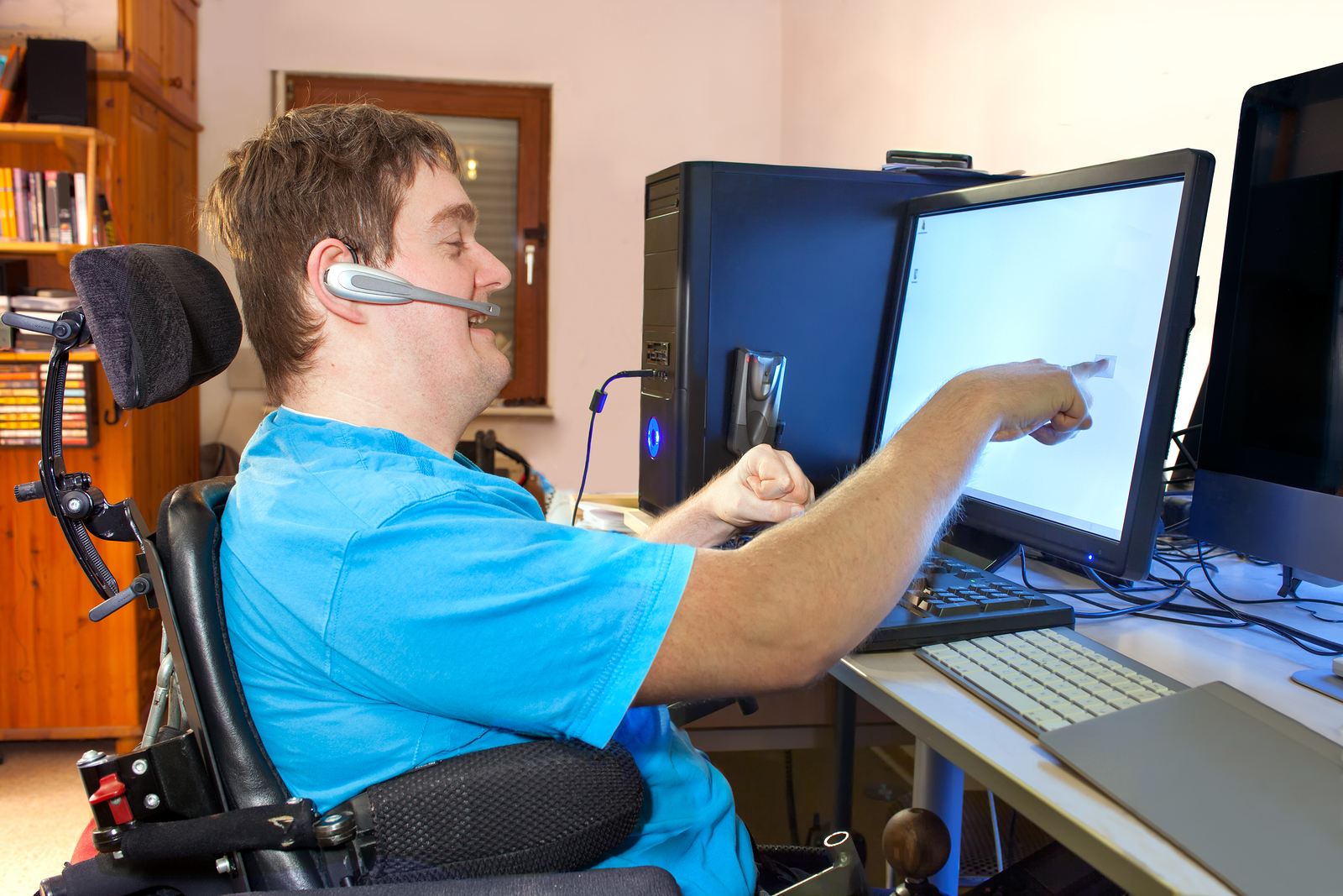 Man uses communication devices while working on the commputer.