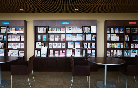 A photo of the Patient Education Resource Center with chairs, tables, and many shelves of informational brochures.