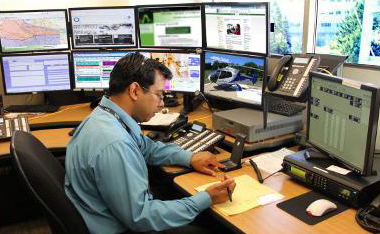 emergency operator takes notes in dispatch center