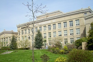 Mackenzie Hall with lawn and landscaping in the foreground