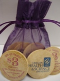 bag of $3 wooden tokens with purple writing