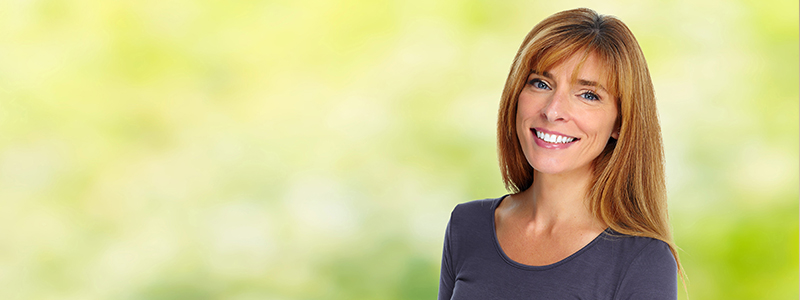 Smiling woman in front of blurred background