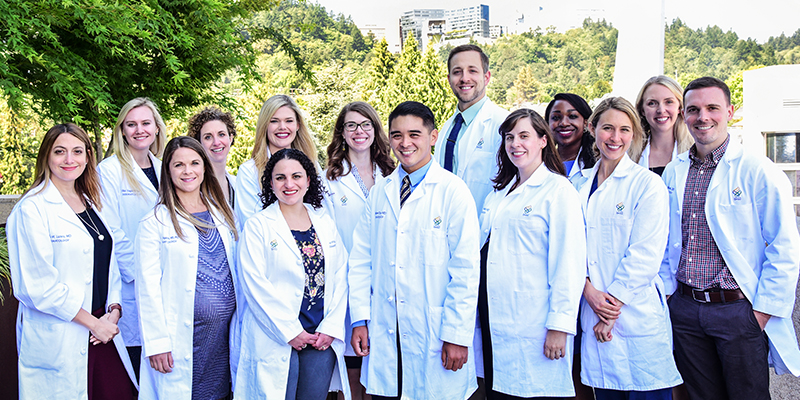 A group photo of dermatology residents.