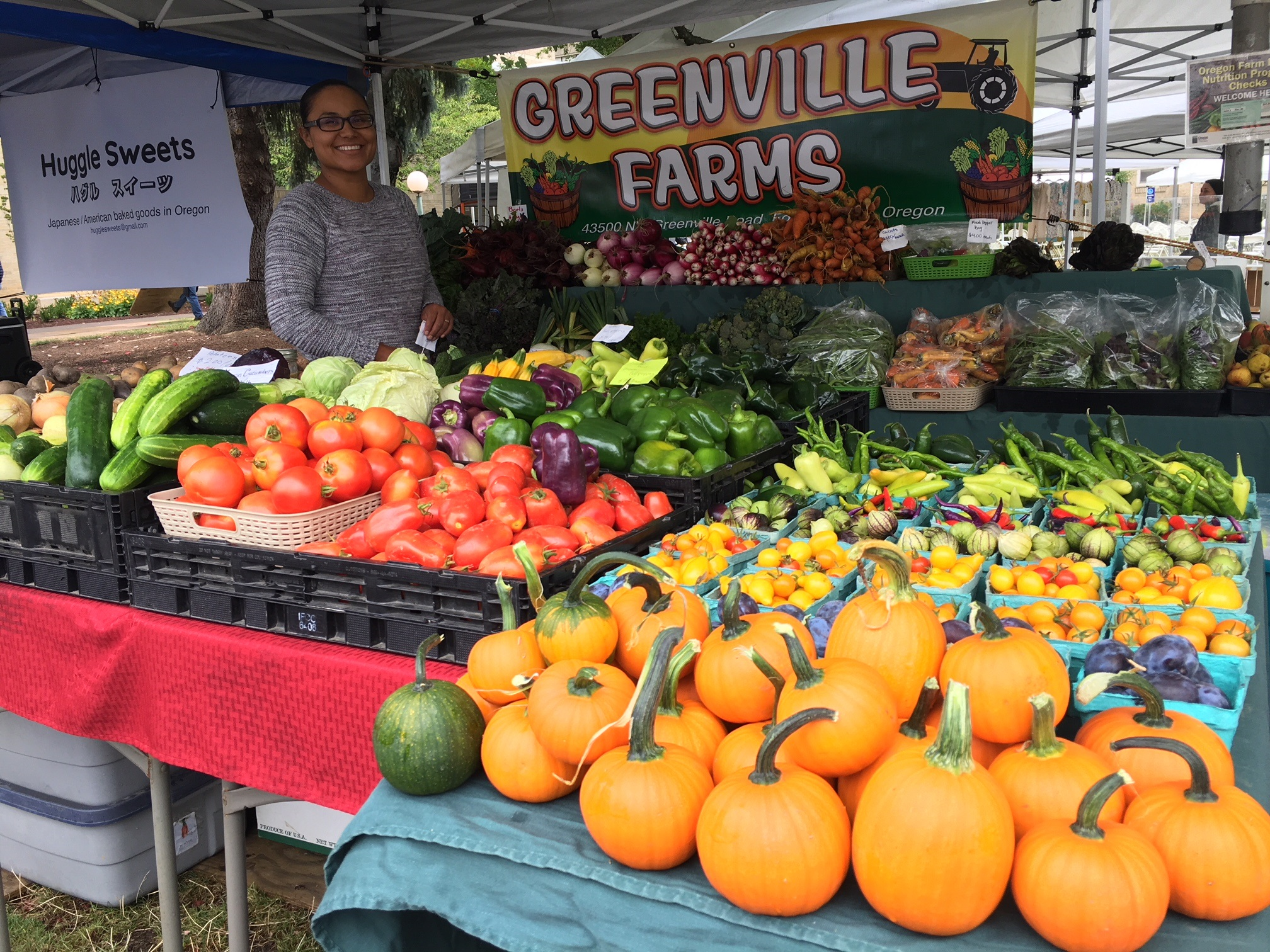 Greenville farms produce, orange squash and tomatoes featured here