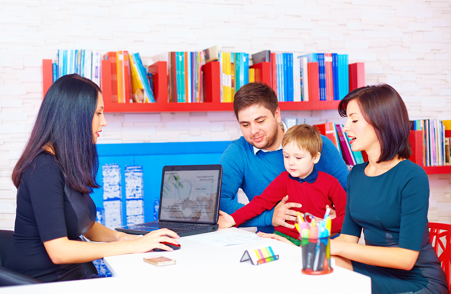A young family at the office of a health care professional