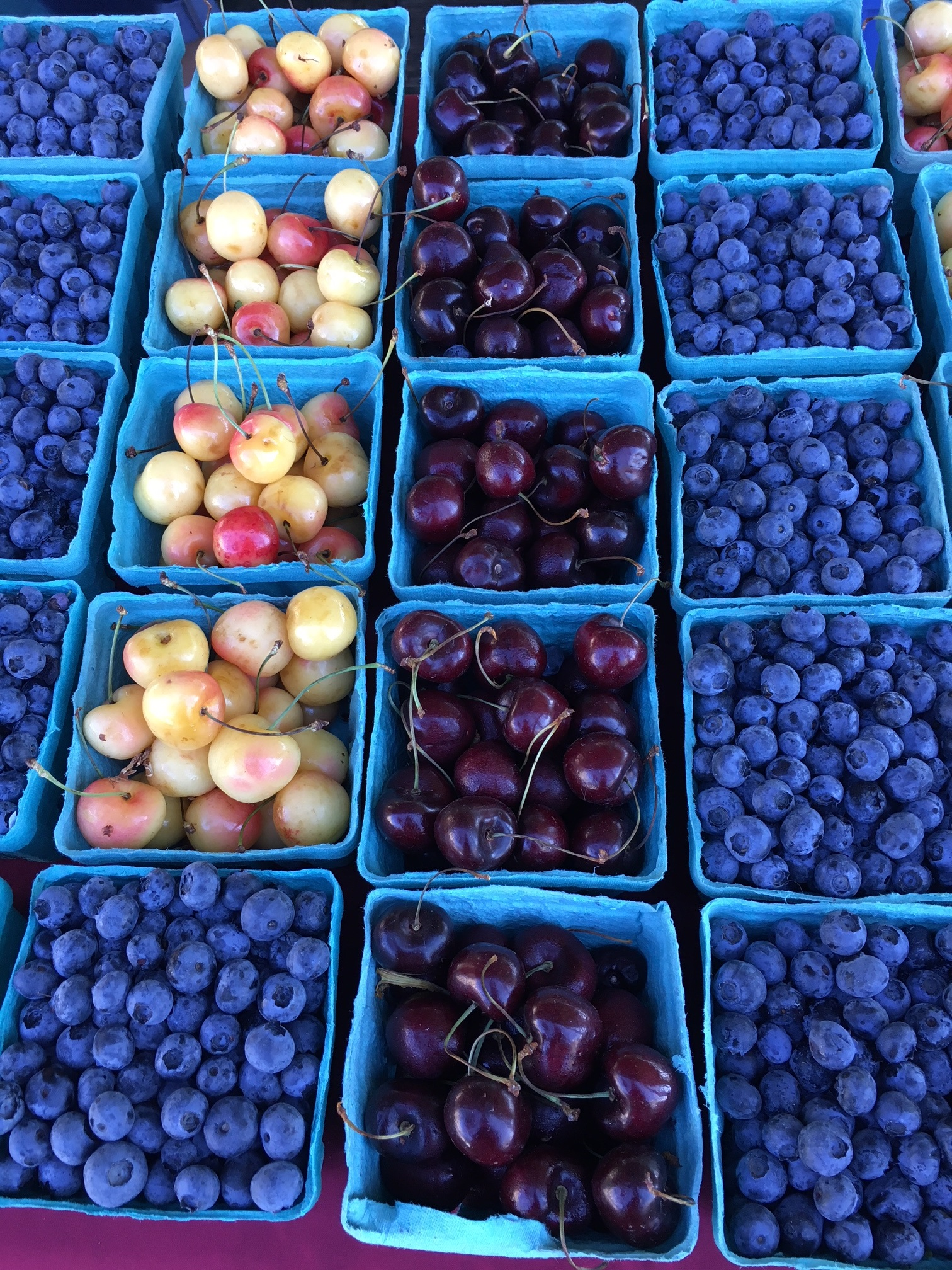 boxes of blueberries and cherries