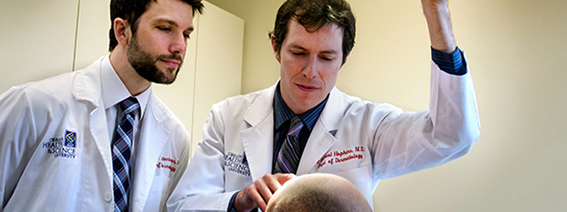 High-Risk Non-Melanoma clinic doctors see a patient.