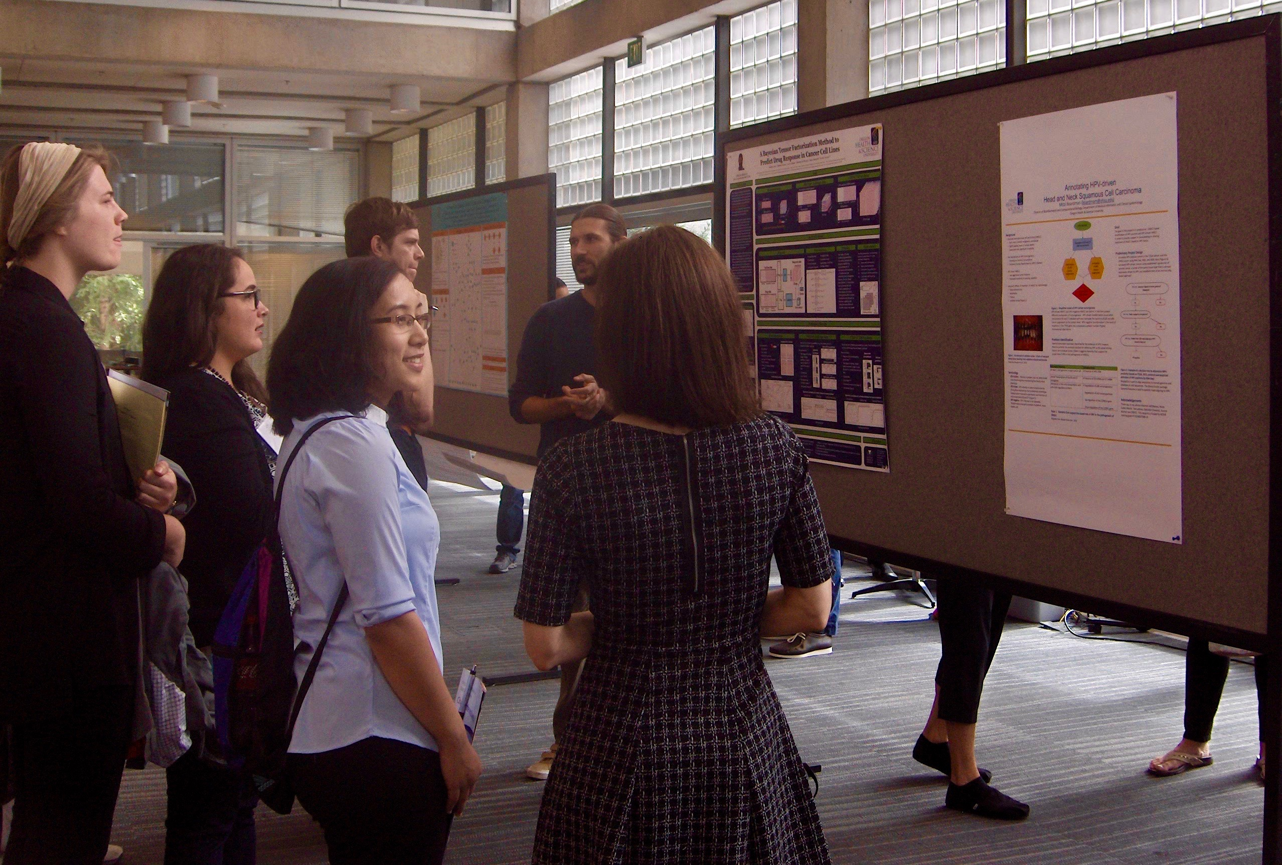 DMICE Students looking at posters