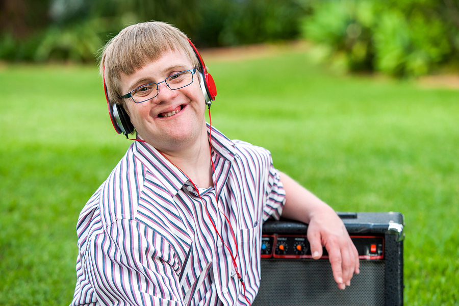 Youth with down syndrome wearing headphones