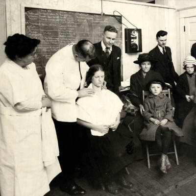 Medical students observe patient care at the Portland Free Dispensary, circa 1909