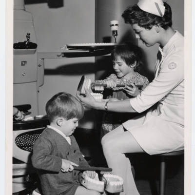 Dental hygiene student, Carol Hays, with young children, circa 1970s