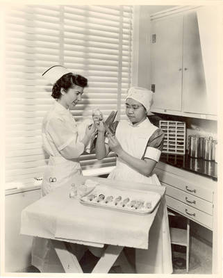 Learning to prepare hypodermic needles, circa 1940s