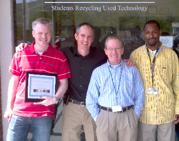 A photo of students recycling used technology and OHSU ITG staff