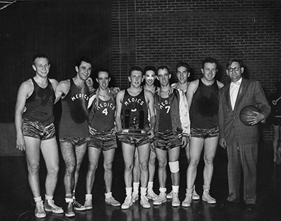 "University of Oregon Medical School ""Medics"" basketball team pose with trophy, circa 1950s. Historical Image Collection."