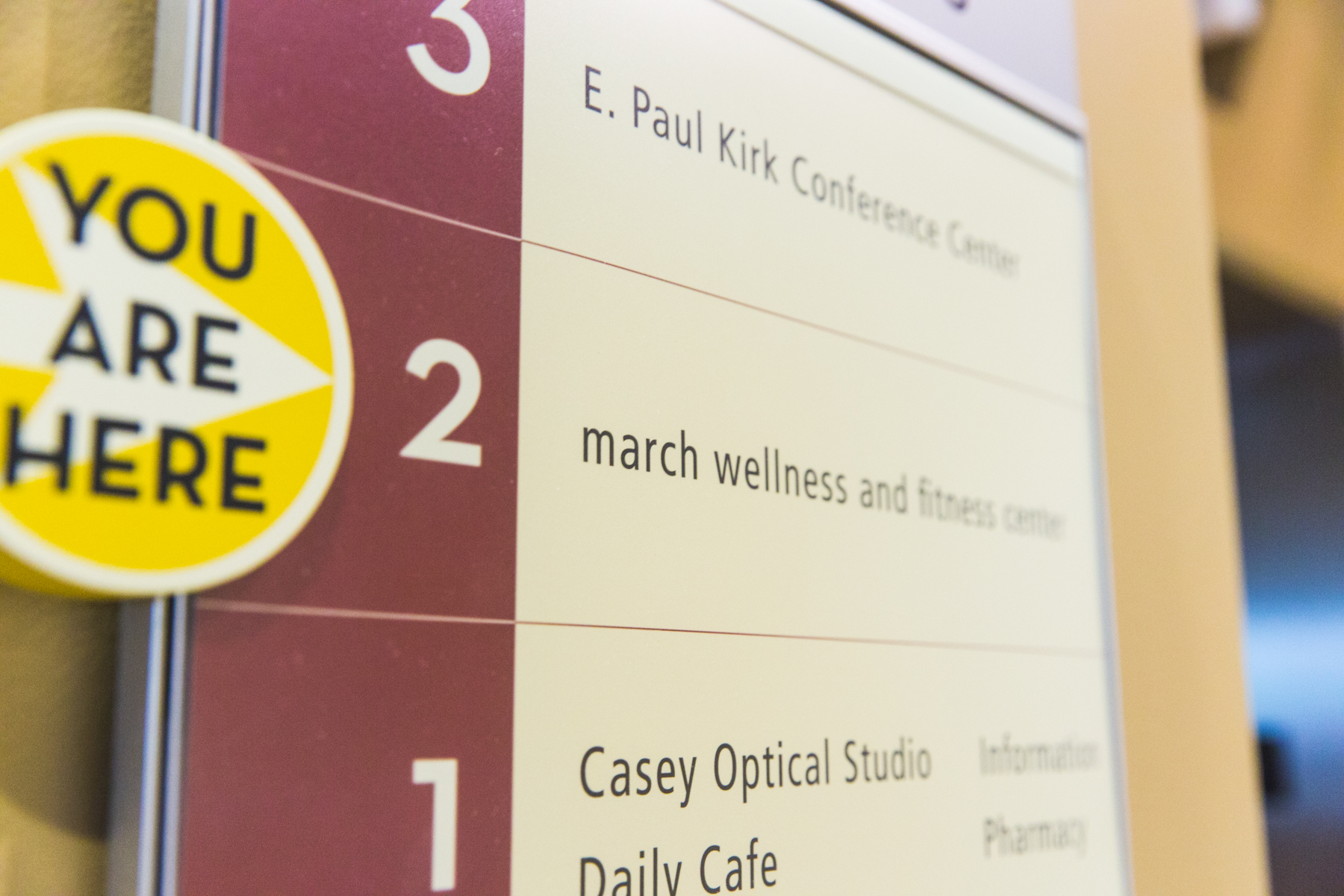 "march wellness & fitness center's ""you are here"" sign in from of march wellness facilities"