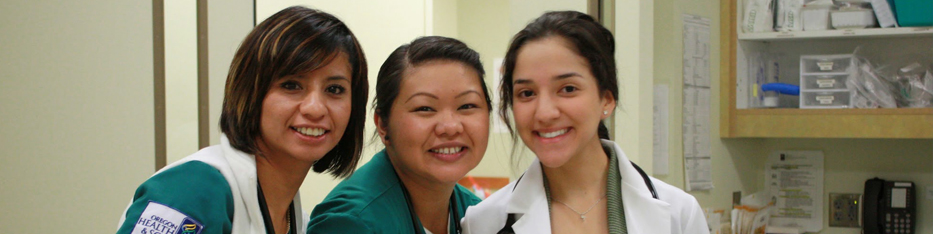 Three female nursing students smiling
