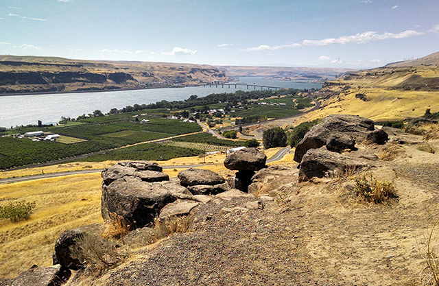 Eastern, agricultural area along the Columbia River Gorge with big boulders in the foreground