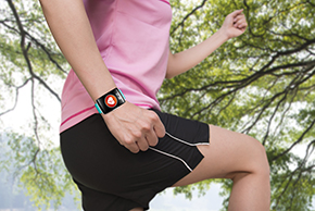 Runner with fitness tracker on wrist
