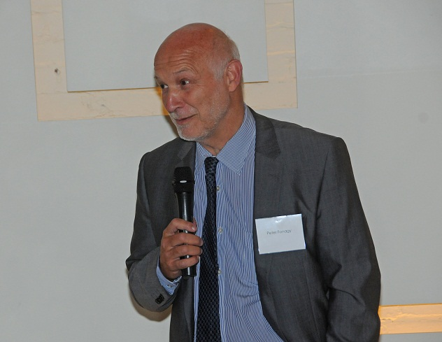 Dr. Peter Fonagy speaking with microphone
