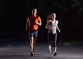 Joggers running at night