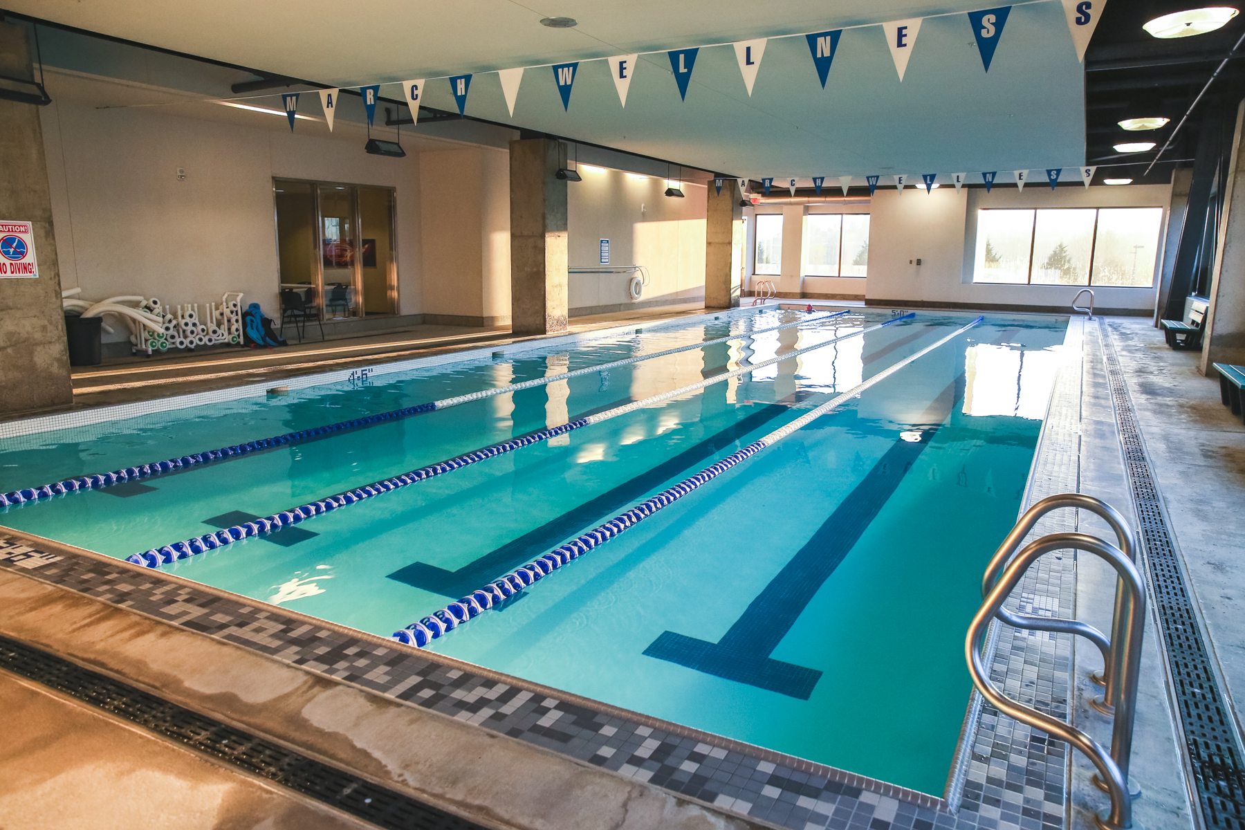 Wide view of march wellness four-lane lap swimming pool.