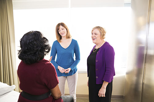 Gynecologic cancer providers discussing treatment options with a patient