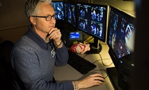An OHSU cardiovascular specialist analyzes digital images using his best in class insight and training.