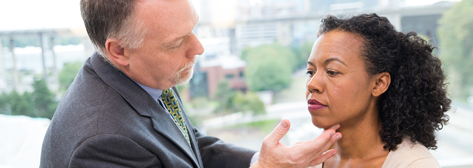Dr. Dana Madison examines a thyroid cancer patient