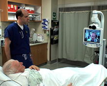 Doctor and hospital patient looking at telemedicine screen