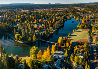 Aerial view of Bend and Deschutes river in the evening in Central Oregon