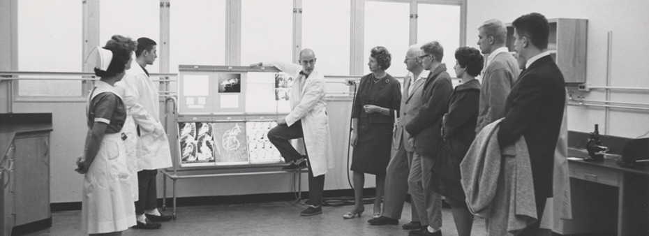 Charles Dotter with a group in the lab