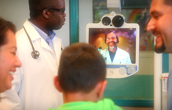 Healthcare Providers of the OHSU Telemedicine Network looking at the screen with a patient