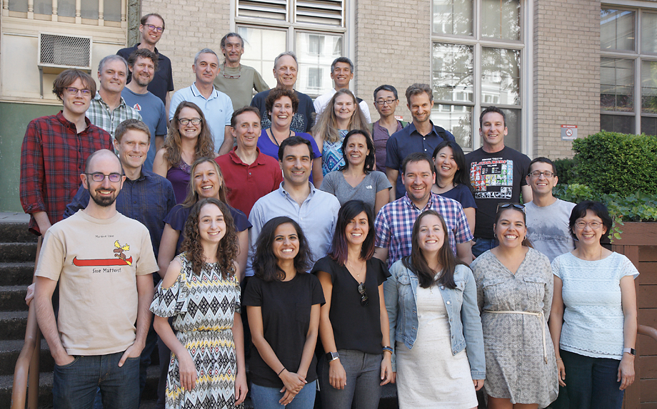 Attendees of the John T. Williams Neuroscience Retreat, July 2018, gather for a group photo in the Mac Hall courtyard