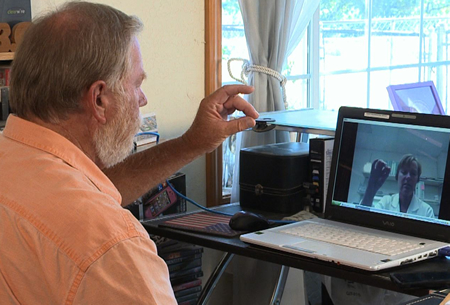 Patient using using Jabber software to connect to telemedicine provider on video