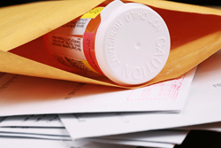Drug bottle in a mailing envelope