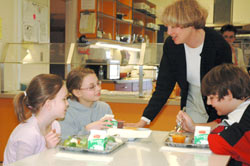 Woman in lunchroom with 3 children