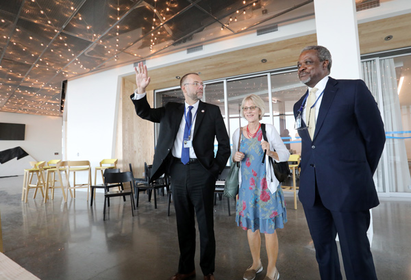 Dr. Tomasz Beer (left), a leading authority on prostate cancer who served on a research Dream Team, tours the Knight Cancer Research Building with OHSU researcher Mary Stenzel-Poore and OHSU President Danny Jacobs.