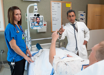 Care team and Patient interacting with physician on screen