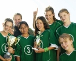 Girl's Soccer Team Holding a Trophy