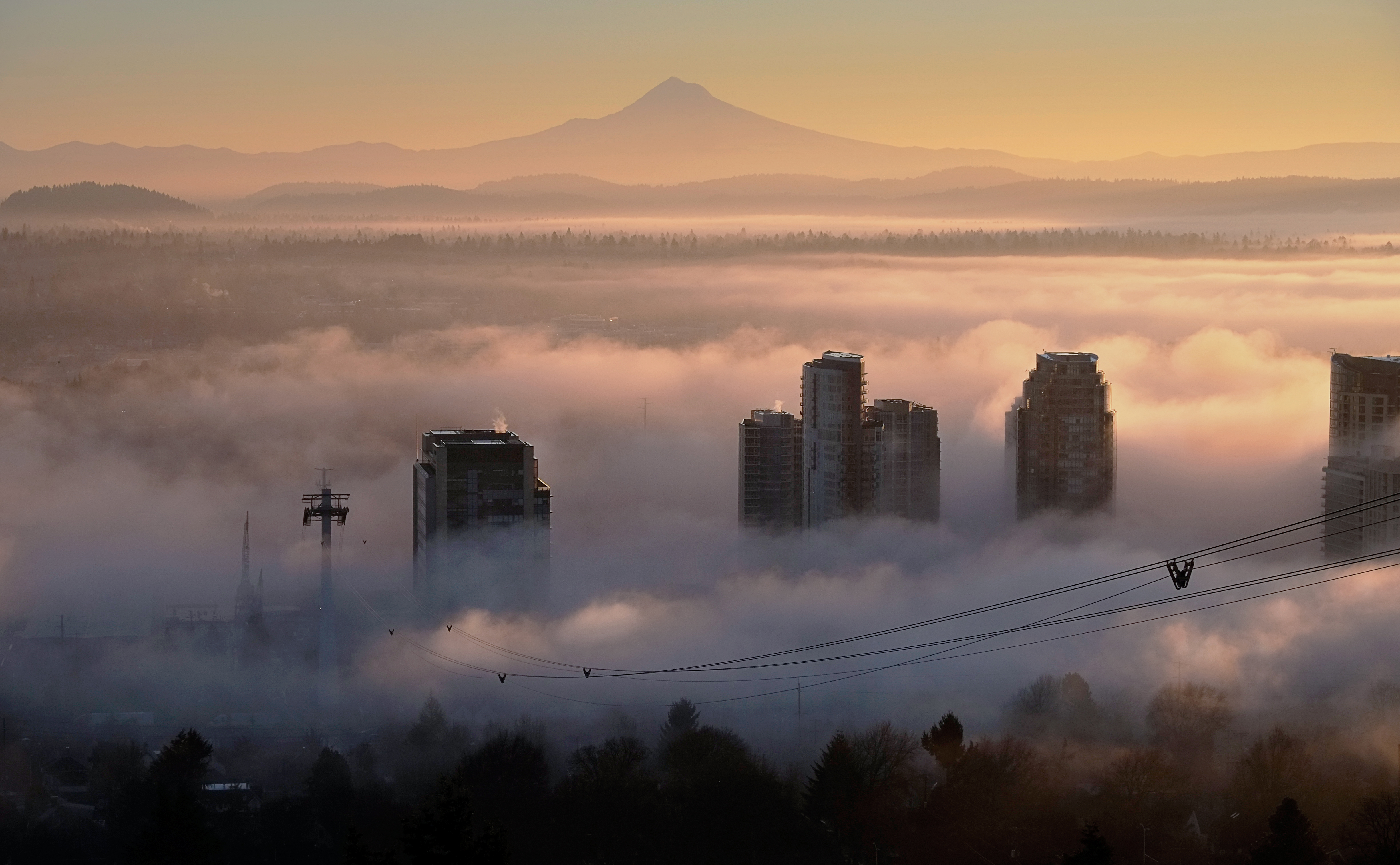 View of Mt Hood in the distance with fog over the South Waterfront