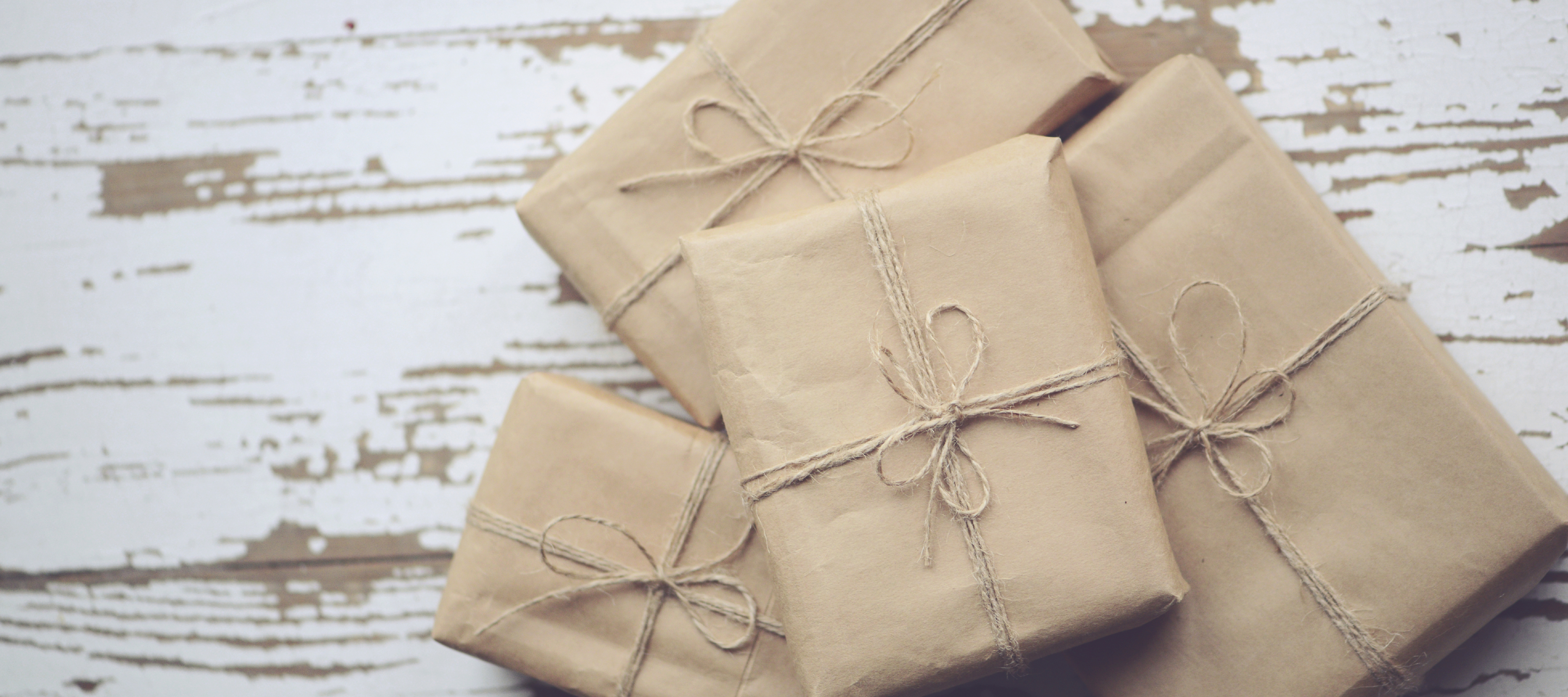 Packages wrapped in brown paper with jute bows