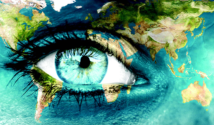 An open eye with the world map painted on the face