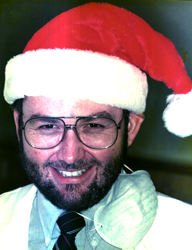 Les Morgan wearing a Santa hat