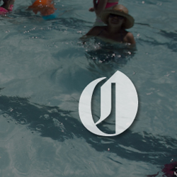 An image of a summer pool scene, with the Oregonian logo transposed on top.