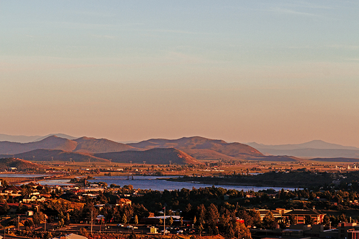 Aerial view of Klamath Falls at sunrise in Southern Oregon with foothills in the background