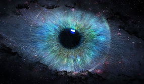 Artistic eye image with iris blending into what looks like the universe.