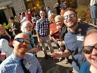 Faculty, staff, and residents enjoying the eclipse