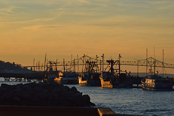 Large bridge with fishing boats in the bay near the North Coast of Oregon